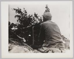 Seated Man At Gun