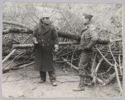 Barney Standing With Chinese Man In Front Of Tree