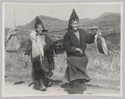 Two Tribal Men Walking
