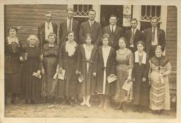 [A Large Family Wearing Their Sunday Best]