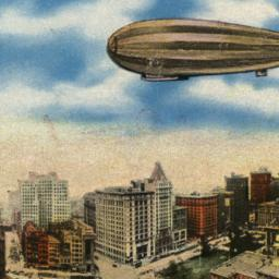 Zeppelin Flying Over City H...