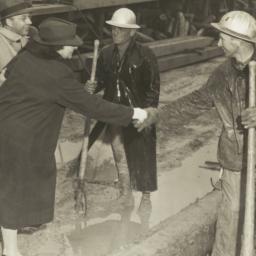 Frances Perkins shakes hand...