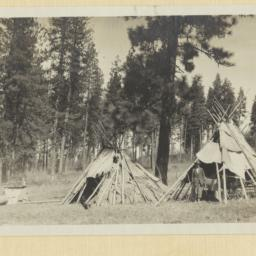 Two Tipis in a Clearing in ...