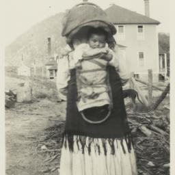Woman with Infant in Cradle...