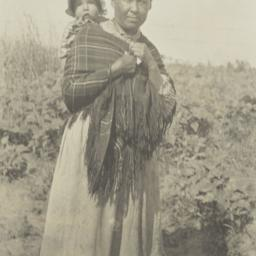 American Indian Woman Carry...