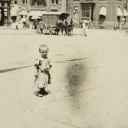 Child in Front of Demilt Di...