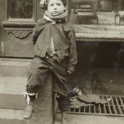Boy Sitting on Stoop
