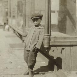 Boy Leaning against Window