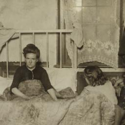 Woman in Bed with Two Children