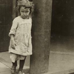 Girl Outside Entrance to Bu...