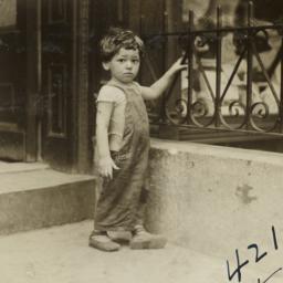 Boy Holding Railing