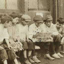 Boys Reading Newspaper