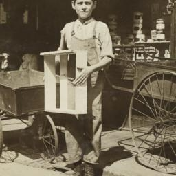 Boy with Box near Empty Pus...