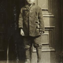 Boy Standing at Entrance to...