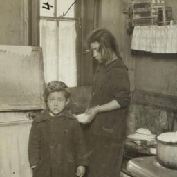 Two Children in Kitchen wit...