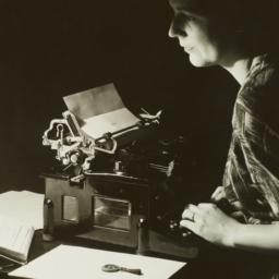 Woman at Typewriter in Dark...