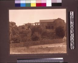 Rear facade\, view from the canyon behind the house.