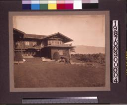 View from garden showing right side of rear elevation of main residence.
