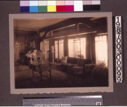 Living room, view with library table and Tiffany lamp.
